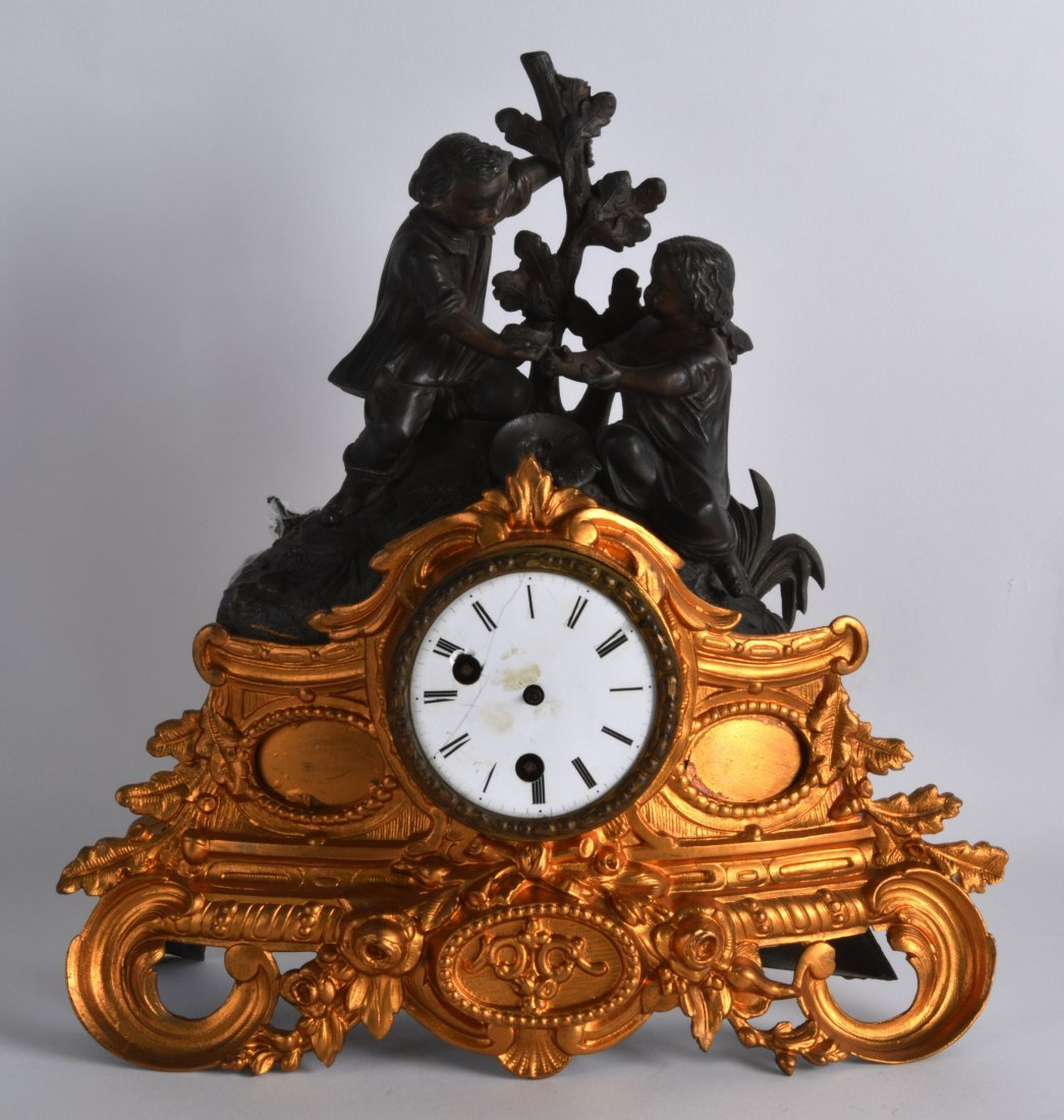 A 19TH CENTURY FRENCH SPELTER AND GILT METAL MANTEL