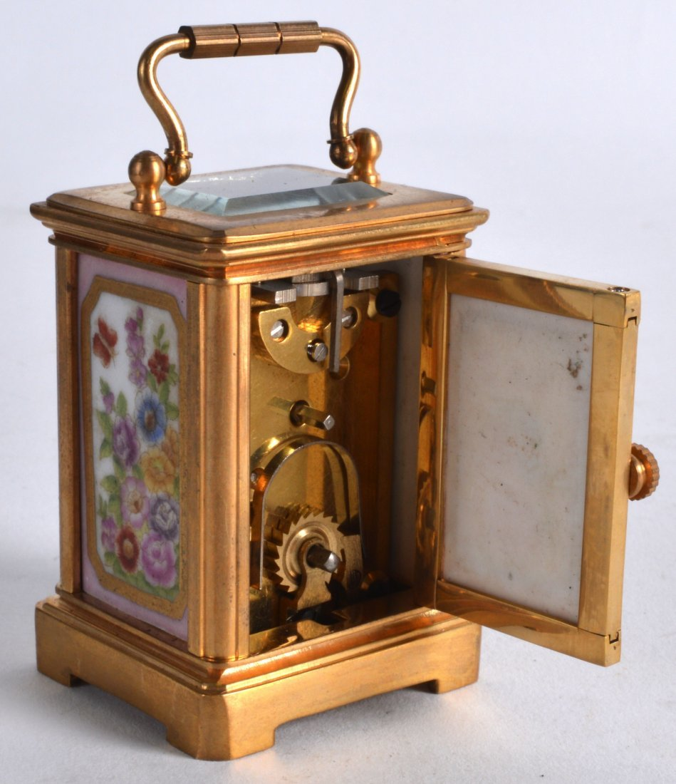 A MINIATURE BRASS CARRIAGE CLOCK inset with painted - 2