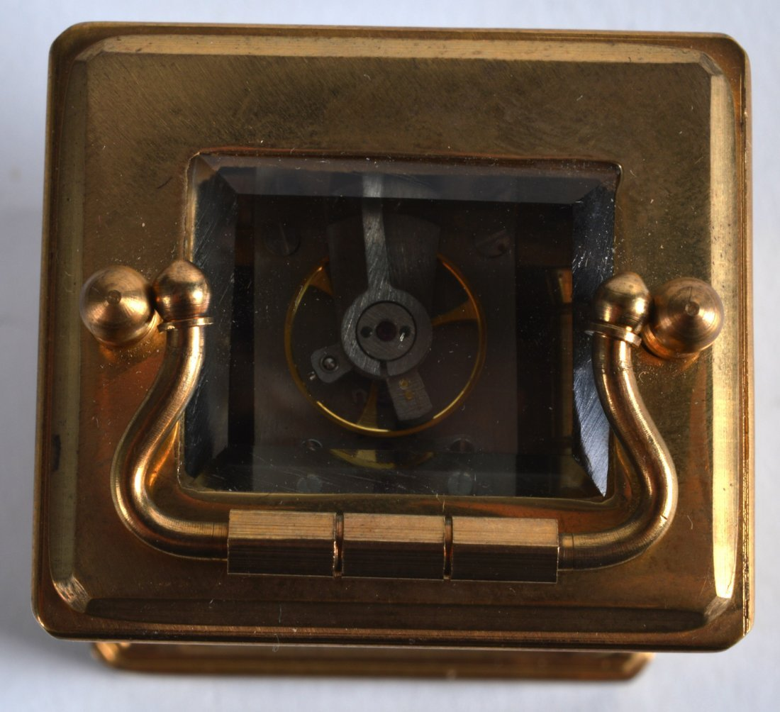 A MINIATURE BRASS CARRIAGE CLOCK inset with painted - 3
