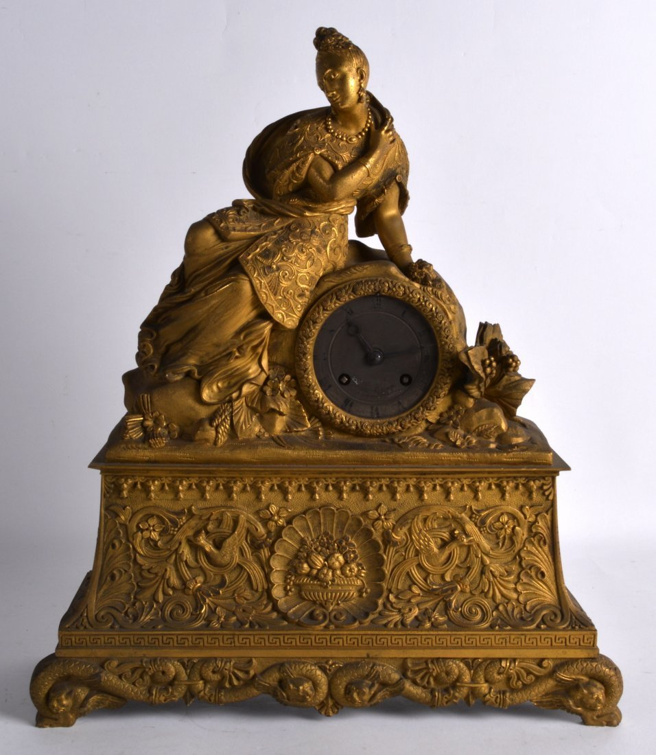 A LATE 19TH CENTURY FRENCH ORMOLU MANTEL CLOCK in the