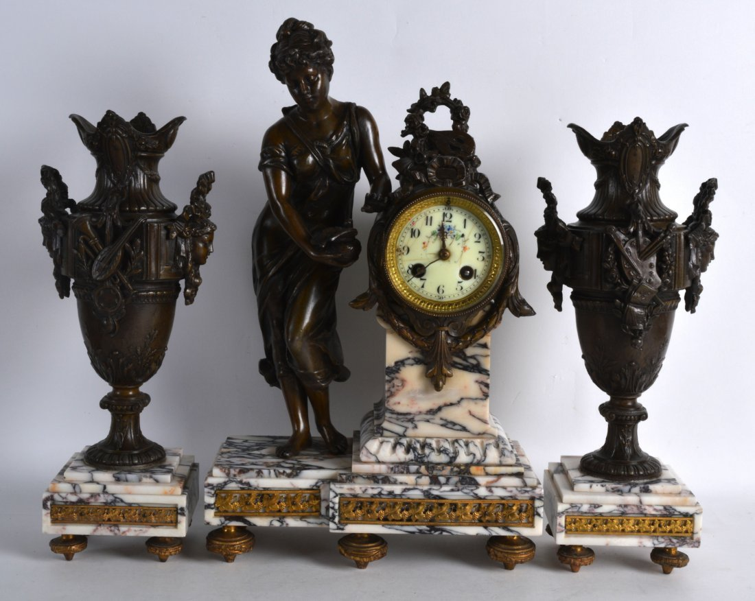 A LATE 19TH CENTURY FRENCH SPELTER CLOCK GARNITURE
