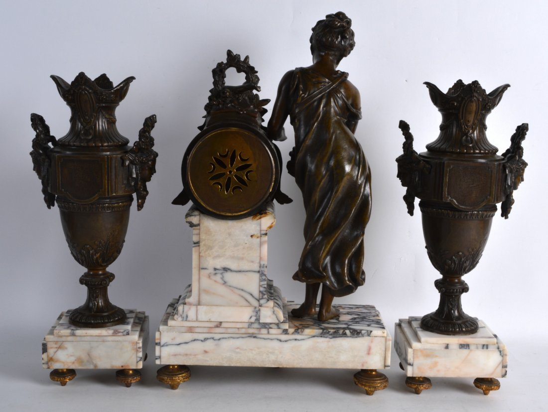 A LATE 19TH CENTURY FRENCH SPELTER CLOCK GARNITURE - 2