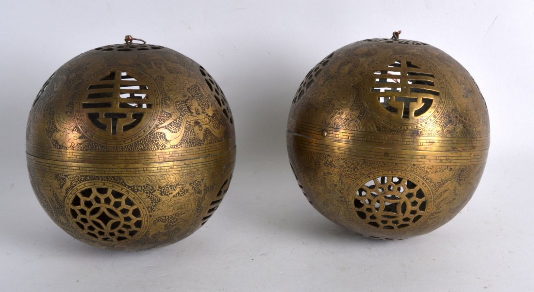 AN UNUSUAL PAIR OF LATE 19TH CENTURY PIERCED BRASS