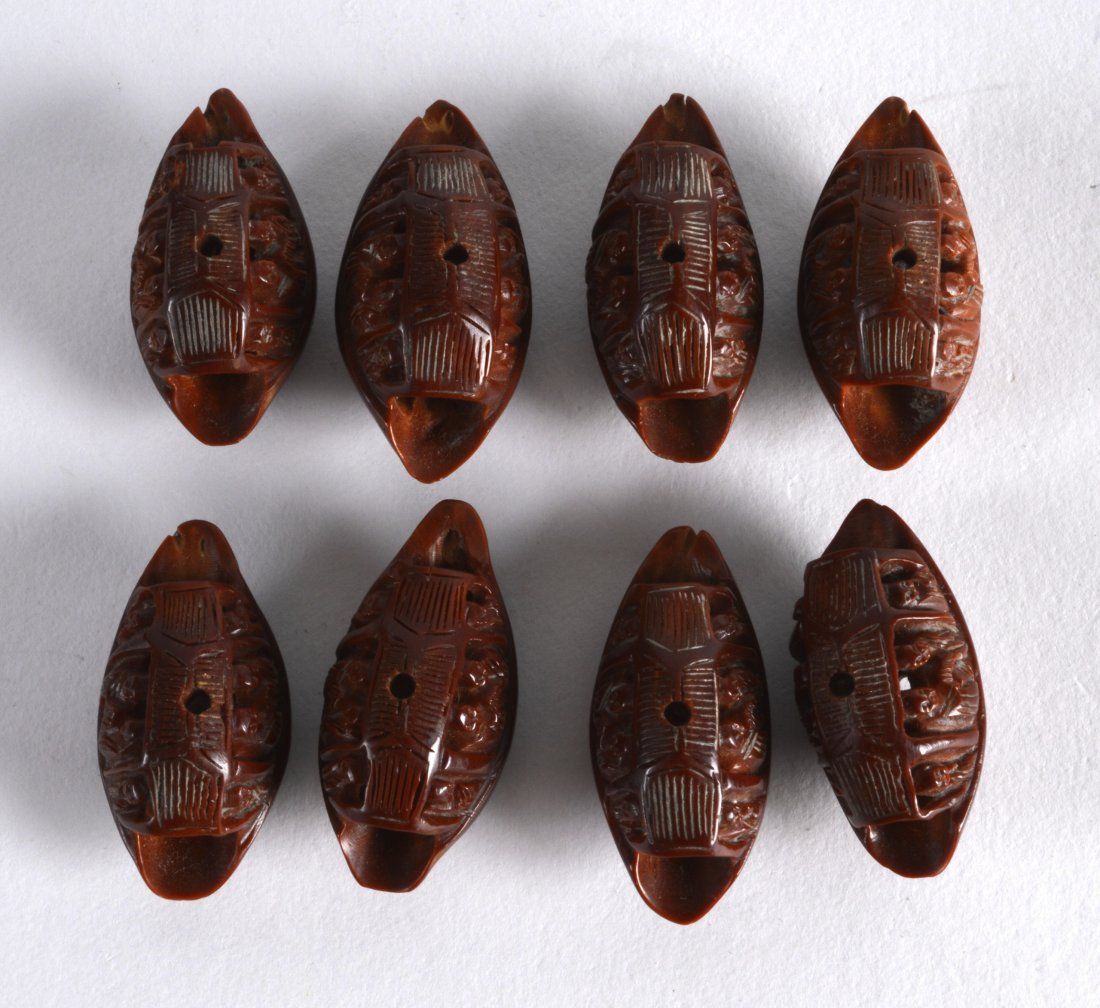 A SET OF EIGHT CHINESE CARVED CANTON NUTS
