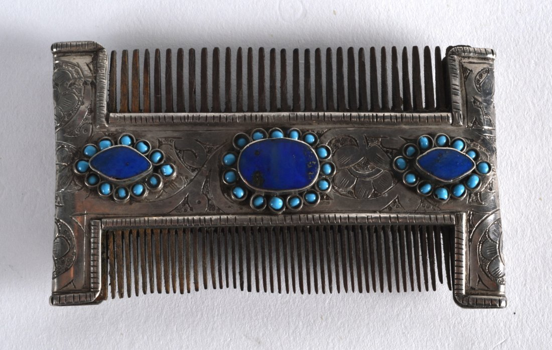 A 19TH CENTURY TIBETAN SILVER COMB inset with three