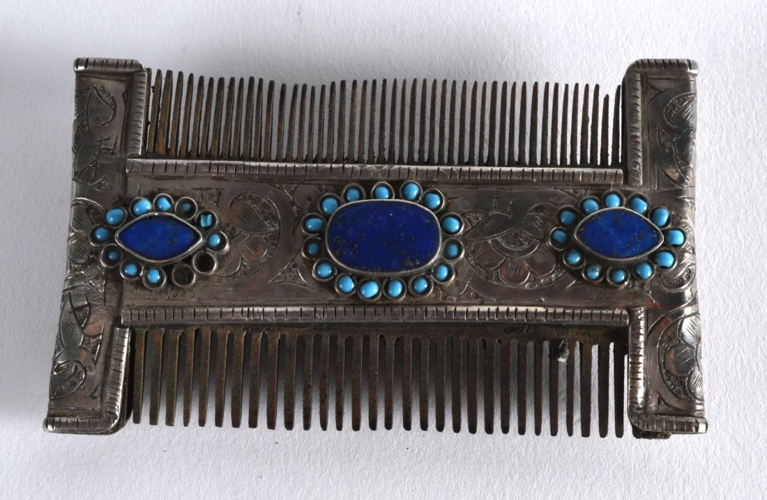 A 19TH CENTURY TIBETAN SILVER COMB inset with three - 2