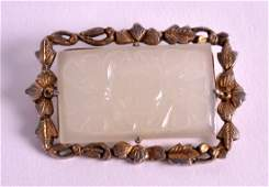 AN EARLY 20TH CENTURY CHINESE CARVED JADE AND SILVER