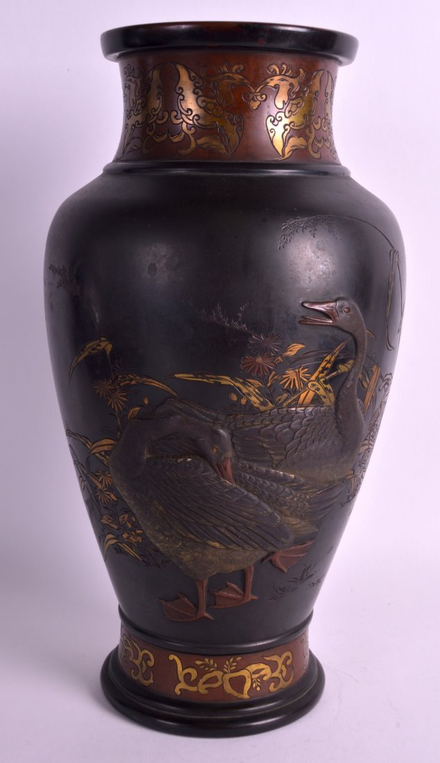 A GOOD 19TH CENTURY JAPANESE BRONZE VASE decorated in
