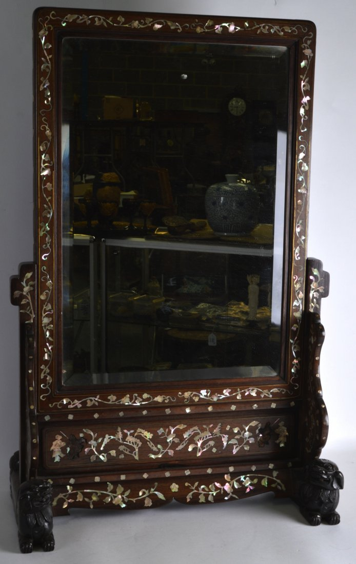 A 19TH CENTURY CHINESE CARVED HONGMU MIRROR ON STAND