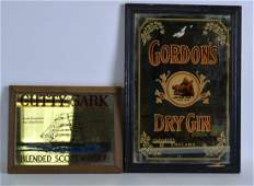 A VINTAGE GORDONS DRY GIN together with a Cutty Sark