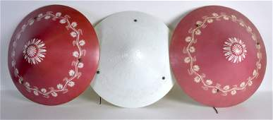 A SET OF THREE ART DECO GLASS LAMPSHADES with scrolling