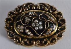 AN ANTIQUE YELLOW METAL DIAMOND ENAMEL AND PEARL
