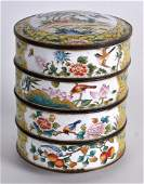 A SET OF FOUR CHINESE CANTON ENAMEL STACKING BOXES &