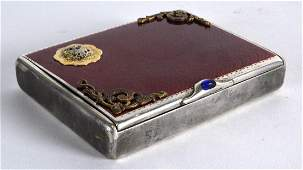 AN EARLY 20TH CENTURY RUSSIAN SILVER AND RED ENAMEL