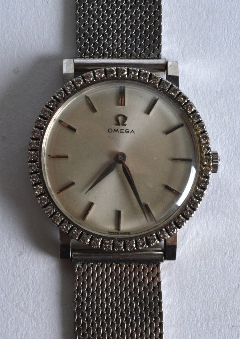 A GOOD 1960S 18CT WHITE GOLD OMEGA AND DIAMOND