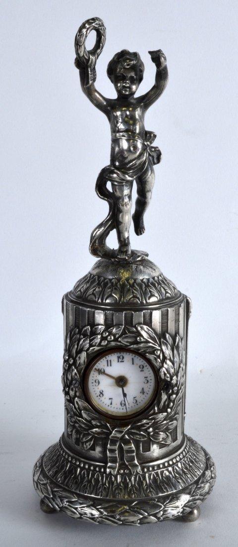 A LATE 19TH CENTURY CONTINENTAL SILVER MANTEL CLOCK