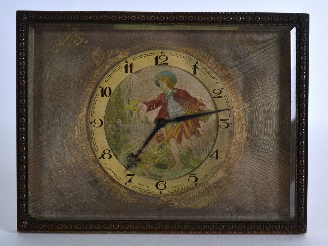 AN EARLY 20TH CENTURY FRENCH BRONZE STRUT MANTEL CLOCK