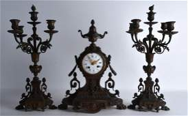 A 19TH CENTURY FRENCH BRONZE CLOCK GARNITURE decorated