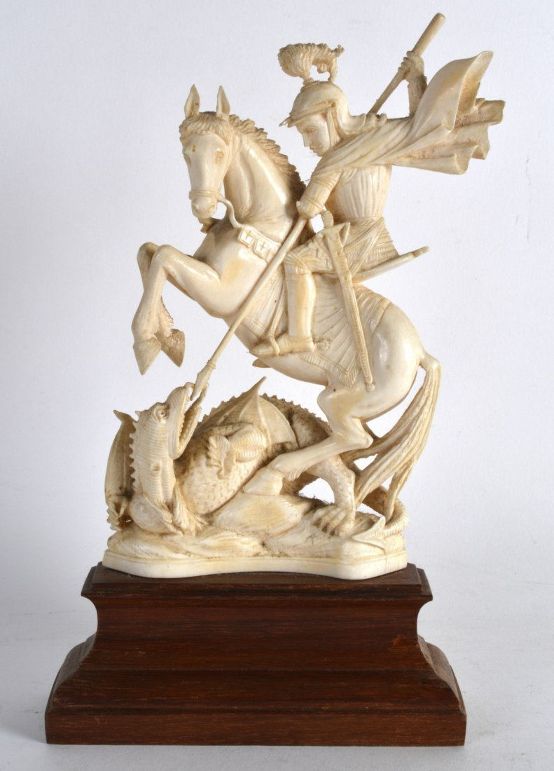 A 19TH CENTURY CARVED IVORY FIGURE OF ST GEORGE AND THE