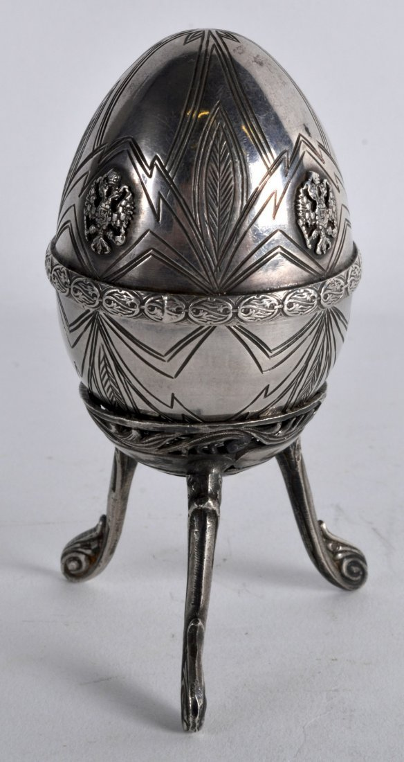 AN UNUSUAL 19TH CENTURY RUSSIAN SILVER EASTER EGG ON