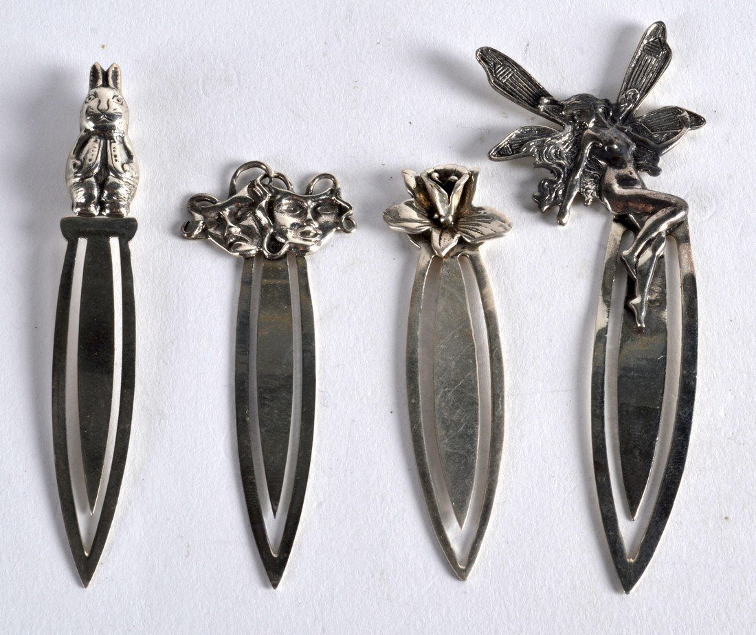 A GROUP OF FOUR NOVELTY SILVER BOOKMARKS. (4)