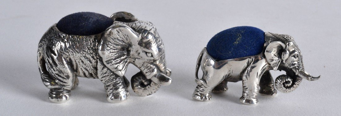 TWO NOVELTY SILVER ELEPHANT PIN CUSHIONS. (2)