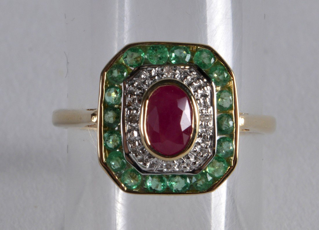 A 9CT EMERALD RUBY AND DIAMOND RING.