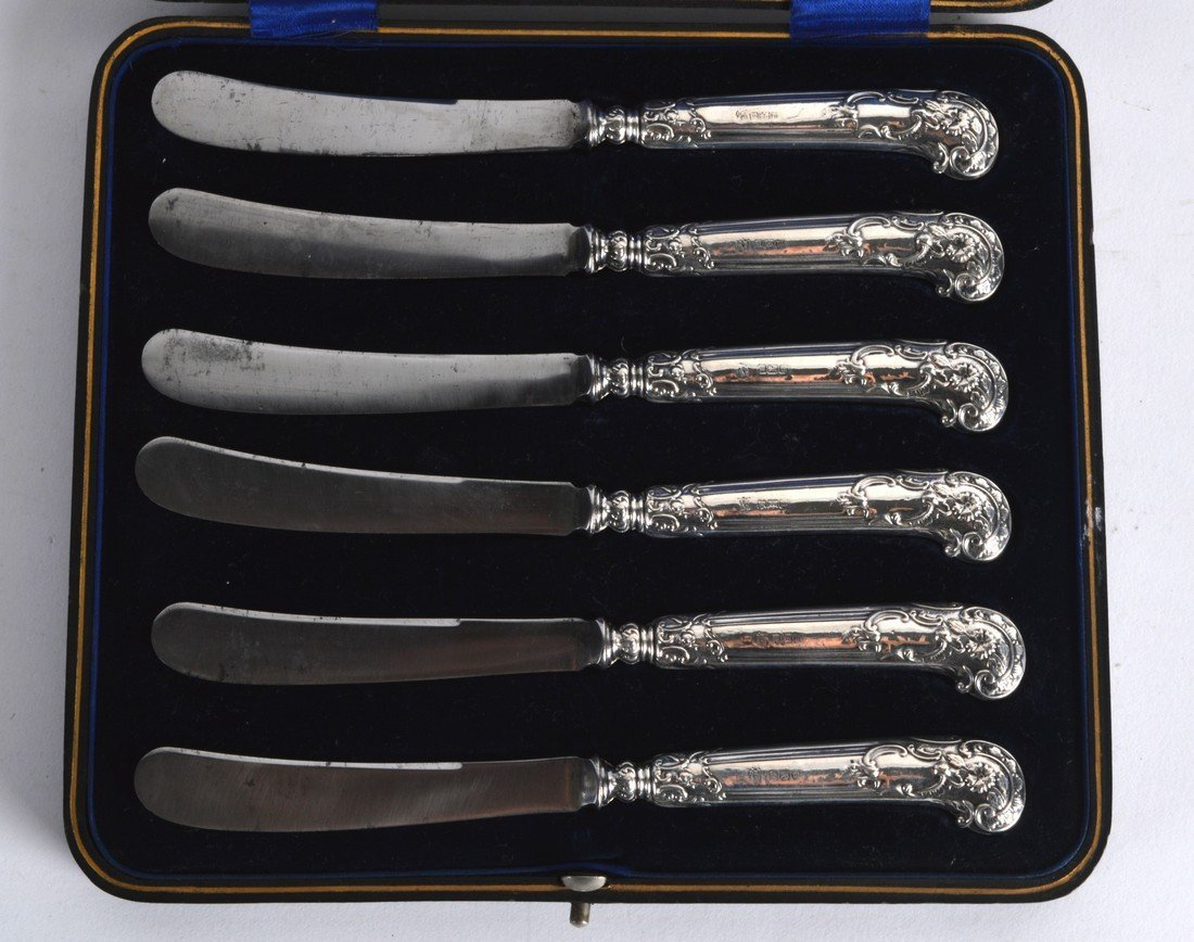A CASED SET OF SIX ENGLISH SILVER HALLMARKED BUTTER