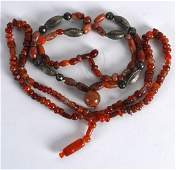 A VERY EARLY CARVED AGATE NECKLACE the hanging pendant