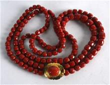 A FINE VICTORIAN CARVED RED CORAL NECKLACE with yellow