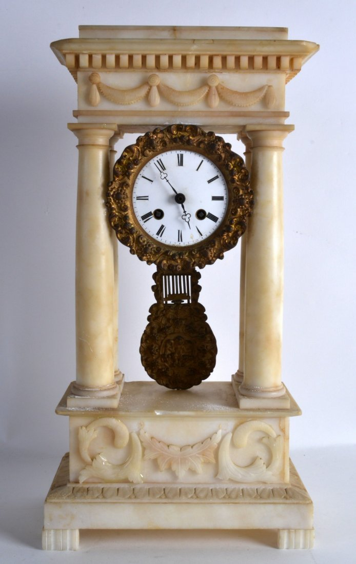 A LATE 19TH CENTURY CARVED ALABASTER PORTICO CLOCK with