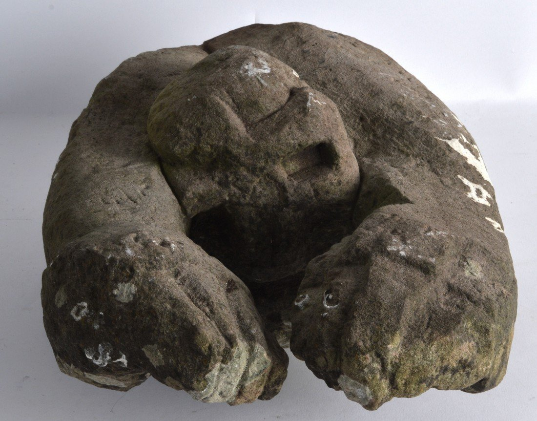 AN EARLY CARVED STONE GARGOYLE TYPE FIGURE modelled