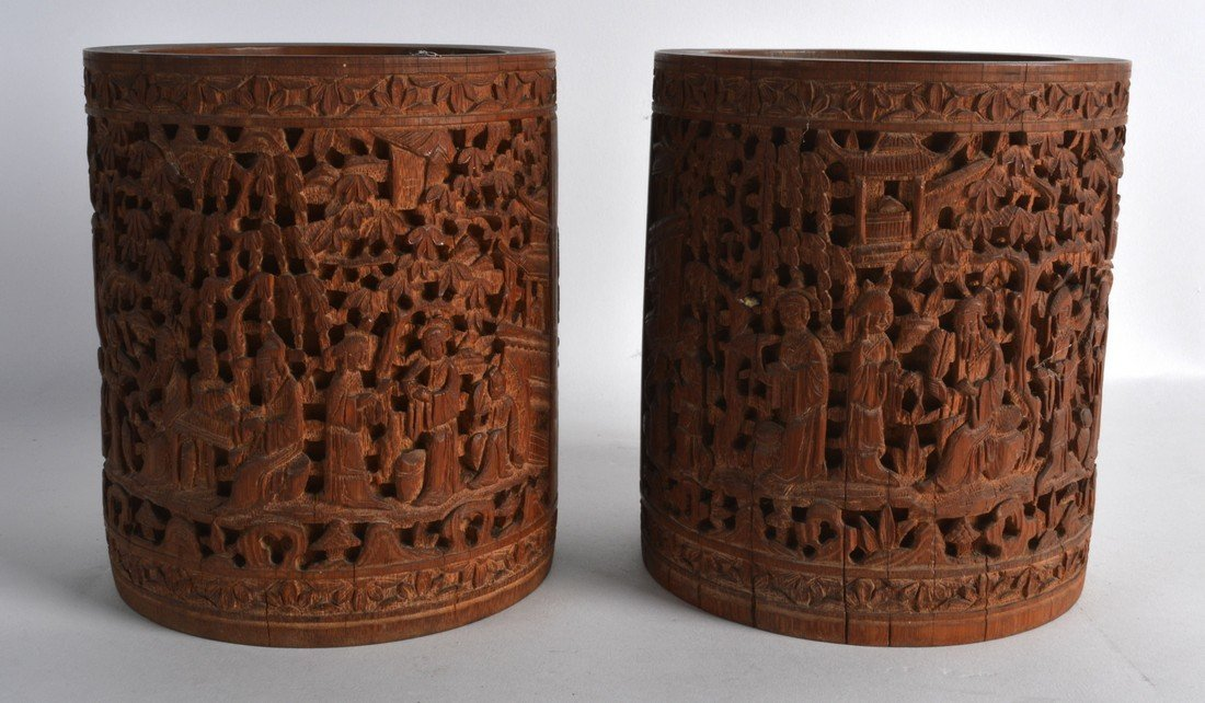 A PAIR OF 19TH CENTURY CHINESE CARVED BAMBOO BRUSH POTS