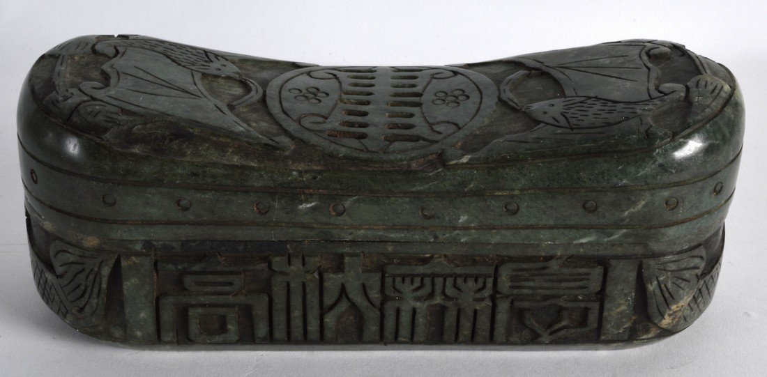A CHINESE CARVED HARDSTONE INGOT SHAPED BOX AND COVER