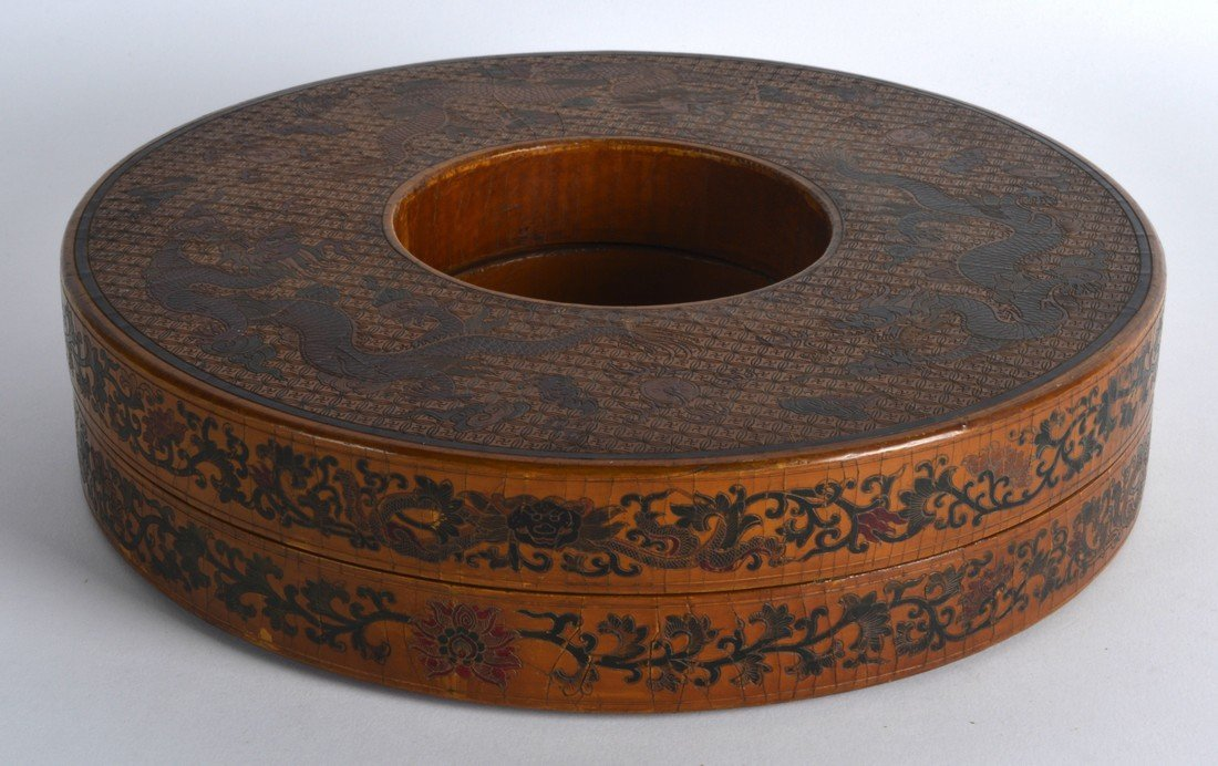 A CHINESE BROWN LACQUER CIRCULAR BOX AND COVER bearing
