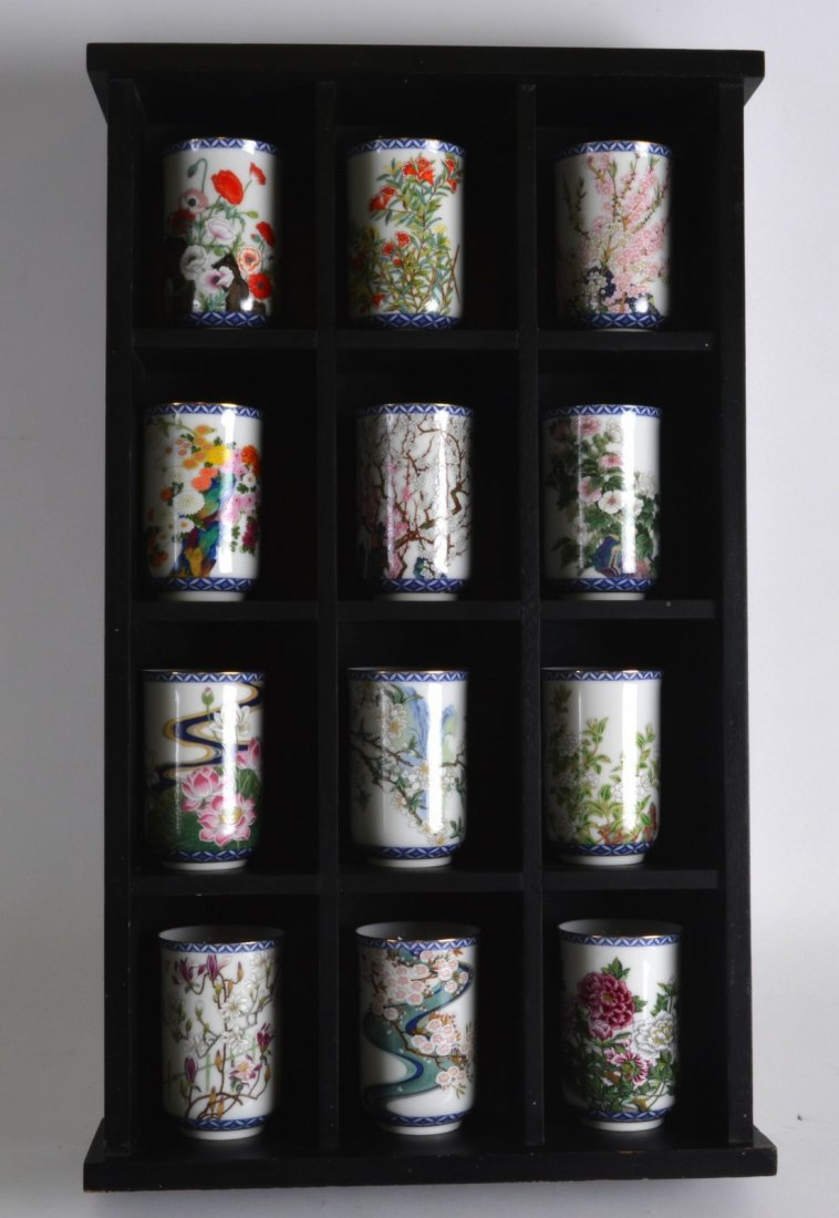 A SET OF TWELVE JAPANESE PORCELAIN VASES 20th Century,