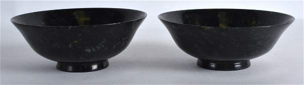 A PAIR OF EARLY 20TH CENTURY CHINESE CARVED JADE BOWLS