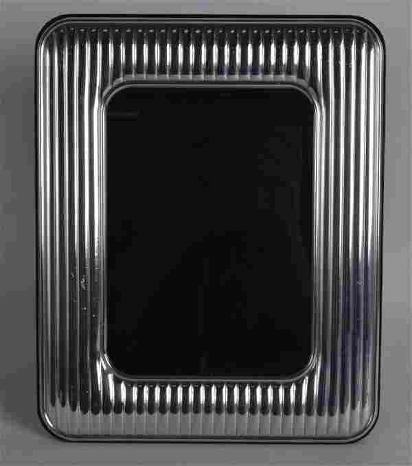 A CONTINENTAL SILVER RIBBED PHOTOGRAPH FRAME. 8.25ins x
