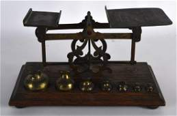 AN EARLY 20TH CENTURY OAK AND BRASS BOUND PAIR OF