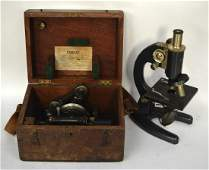 A BOXED ANTIQUE PRIOR MICROSCOPE together with a