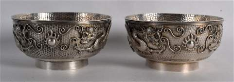 A GOOD PAIR OF 19TH CENTURY CHINESE EXPORT SILVER BOWLS