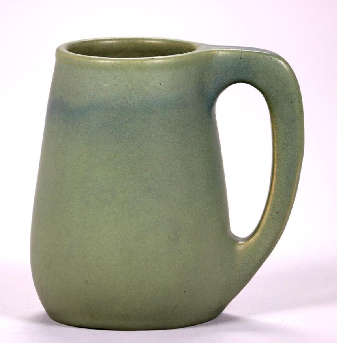 Early Van Briggle matte green mug dated 1905.