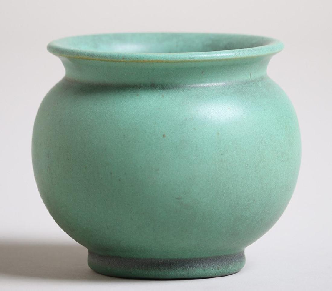 Teco matte green flared bulbous vase.