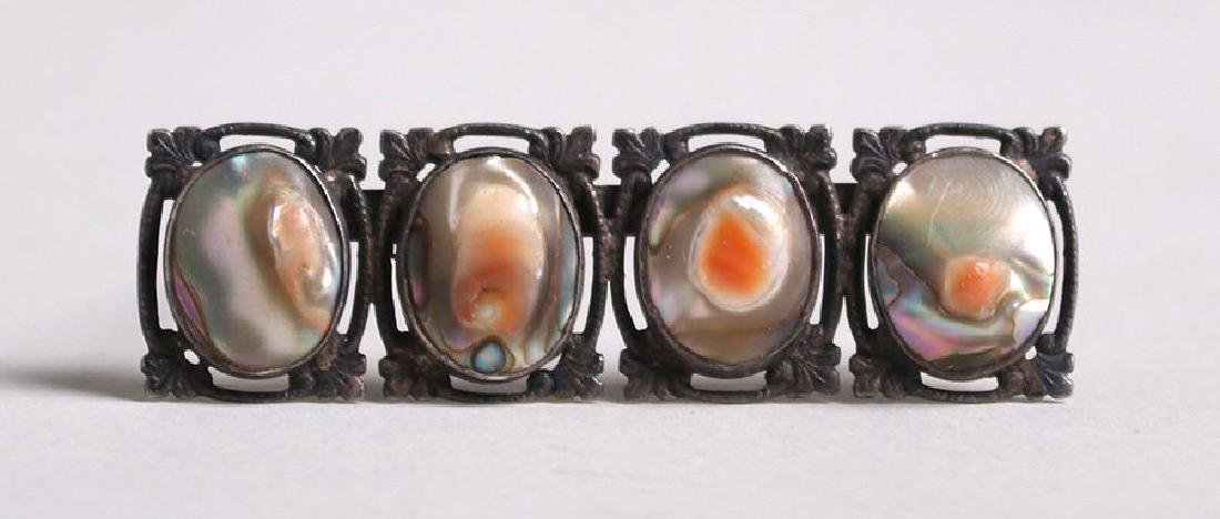 Arts & Crafts sterling silver four-section brooch with