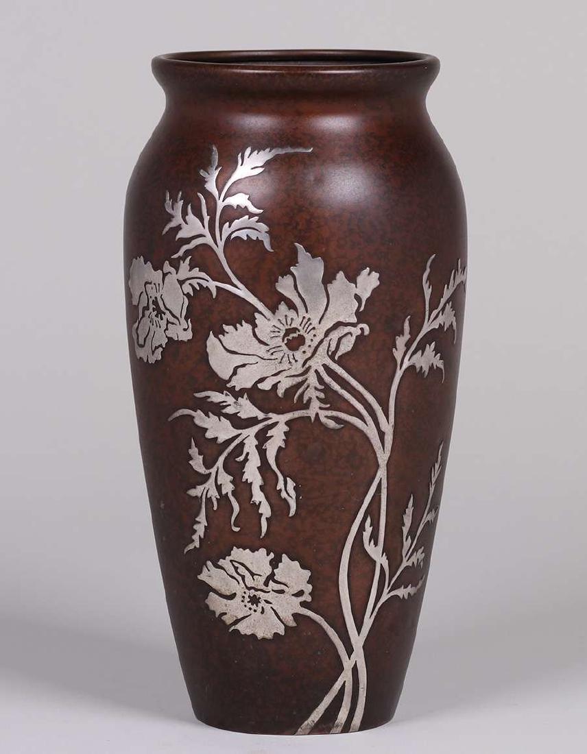 Heintz sterling on bronze tall vase.