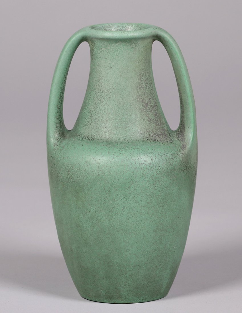 Tall Teco Pottery two-handled matte green vase