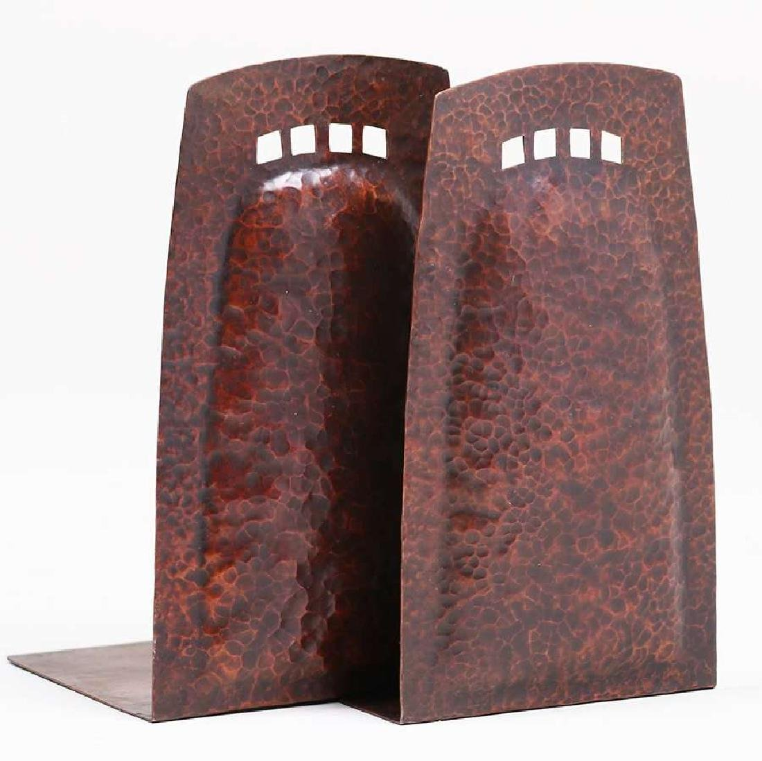 Arts & Crafts hammered copper cutout bookends c1910.