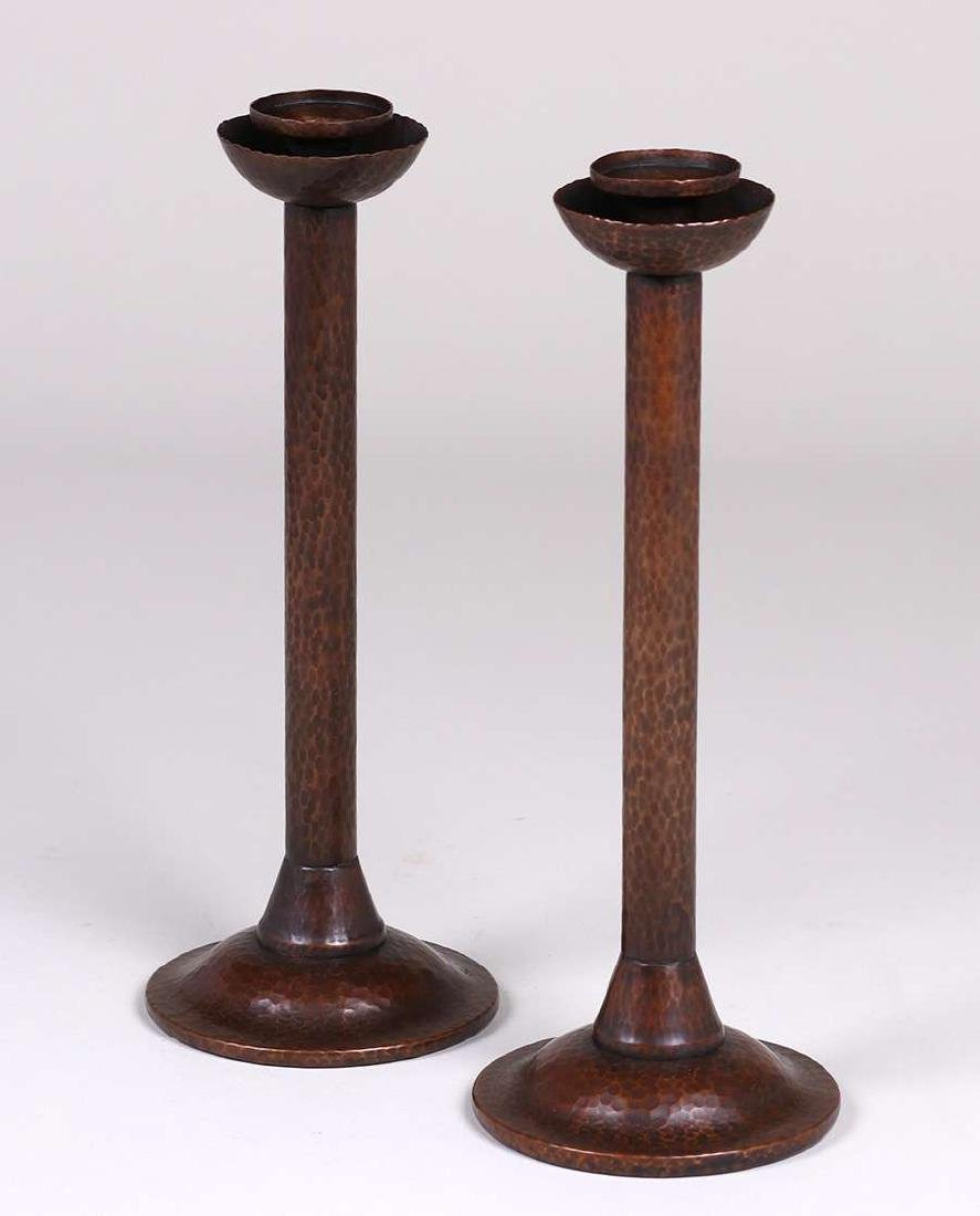 Pair tall Arts & Crafts hammered copper candlesticks