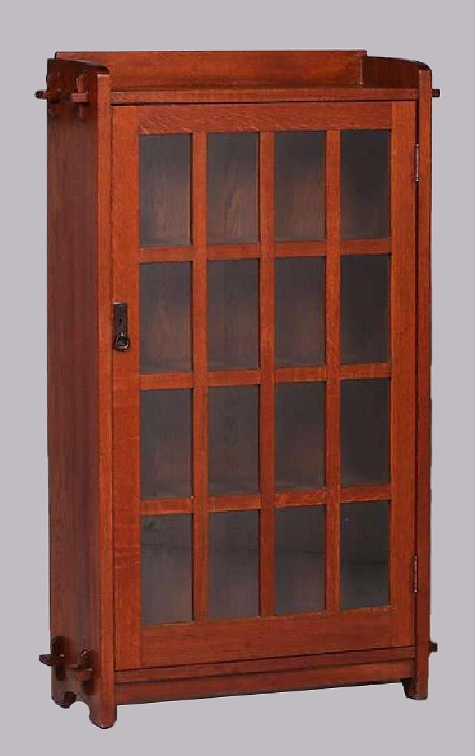 Pair of L&JG Stickley narrow one-door bookcases with