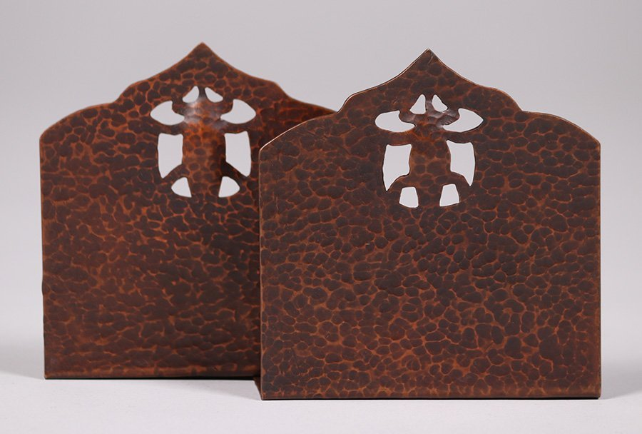 Pair Arts & Crafts hammered copper bookends with cutout